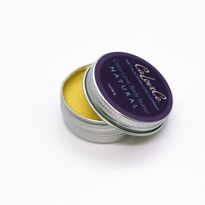 Body butter in natural scent, yellow butter in open tin